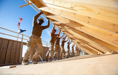 800px-US_Navy_101104-N-6383T-508_Seabees_assigned_to_Naval_Mobile_Construction_Battalion_(NMCB)_18_erect_an_exterior_wall_for_a_Southwest_Asian_Hut_at_Ka